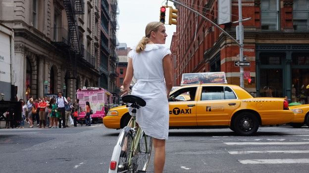 A woman rides down a Manhattan street on a bicycle in New York City. Like many major metropolitan areas, New York has witnessed a surge in bicycle use and plans to launch a bike-share plan by next summer.  (Getty Images)