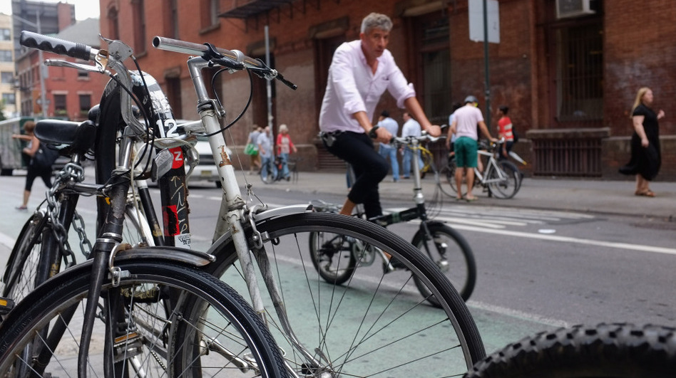 A man rides down a Manhattan street on a bicycle in New York City.  (Getty Images)