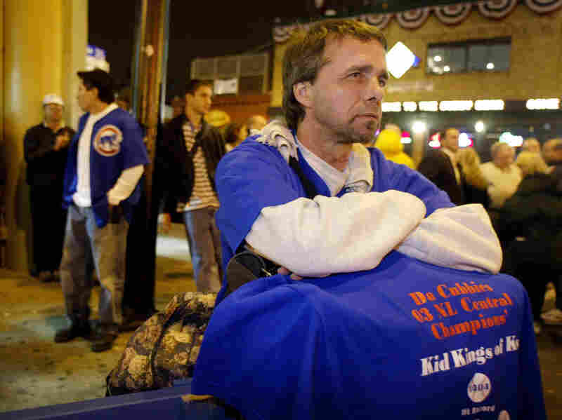 Ted Zegarski and other dejected Cubs fans hang out in front of Wrigley Field as the Chicago Cubs were beaten by the Florida Marlins in Game 7 of the National League Championship Series on Oct. 15, 2003.