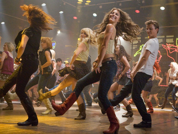 """<p><strong>Kickin' It, New School:</strong> Julianne Hough (center) and Kenny Wormald (right) anchor the <em>Footloose </em>remake — which <a href=""""http://www.npr.org/blogs/monkeysee/2011/10/14/141346943/cuttin-loose-with-the-original-footloose-and-its-superior-remake"""">stands up pretty well</a> to the original.</p>"""
