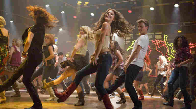 Kickin' It, New School: Julianne Hough (center) and Kenny Wormald (right) anchor the Footloose remake — which stands up pretty well to the original.