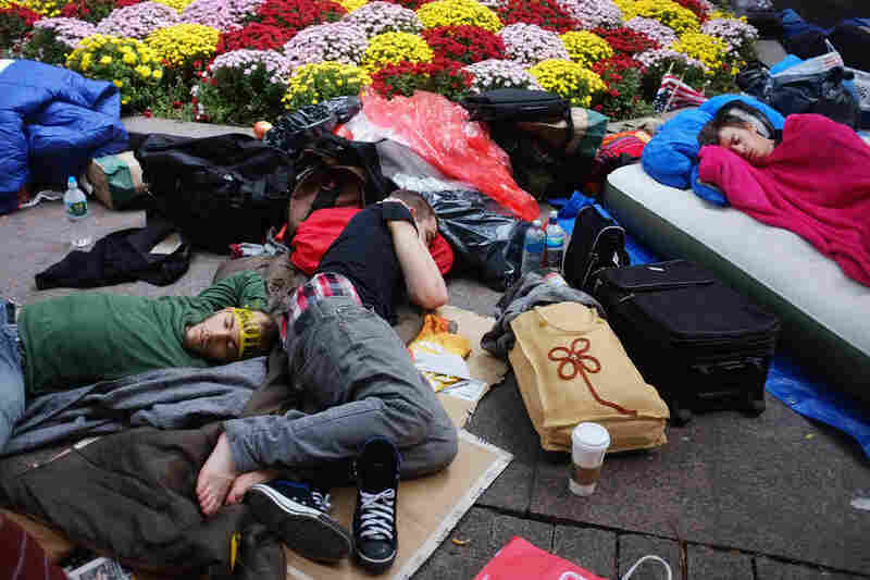 Protesters sleep in the park on Sept. 26. Nearly 80 people were arrested the weekend before in a series of incidents with the police as the protesters attempted to march uptown.