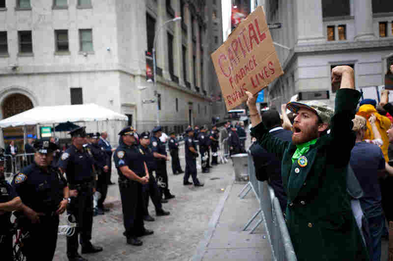 Protesters march on Wall Street amid heavy police presence on Sept. 20 in Manhattan. The demonstrators, who have been camping overnight in nearby Zuccotti Park since Sept. 17, were surrounded by police officers around the clock.