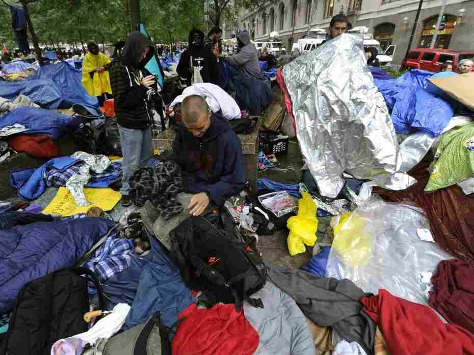 The scene at Zuccotti Park on Thursday as Occupy Wall Street protesters started their own cleanup.