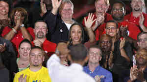 President Obama waves to the crowd after speaking at a GM plant Friday in Michigan. Obama and South Korean President Lee Myung-bak visited the plant to promote a free trade agreement.