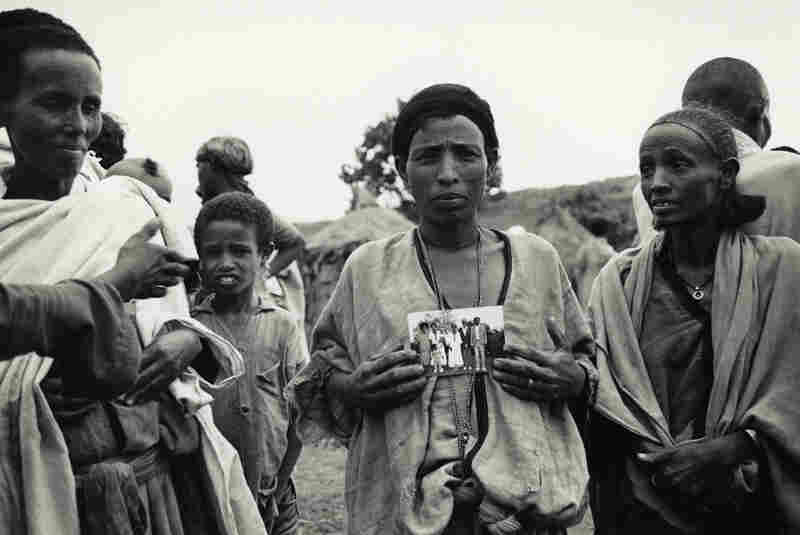 An Ethiopian Jewish mother with a photograph of her children, who had already immigrated to Israel, Ethiopia, 1985