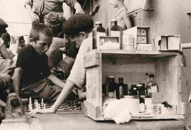 Children playing chess aboard the Henry Gibbins, 1944
