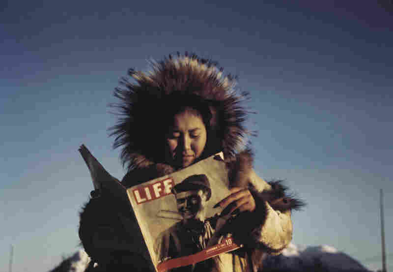 Eklutna woman reading Life Magazine, Hooper Bay, Alaska, 1941-43