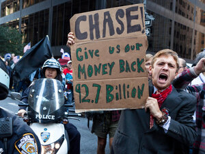 As many as 1,000 Occupy Wall Street protesters marched to a Chase bank in New York's financial district to decry corporate greed.