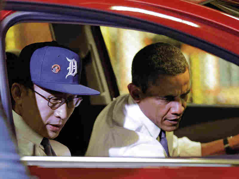 President Obama and South Korean President Lee Myung-bak, wearing a Detroit Tigers baseball cap, check out the interior of the subcompact Chevrolet Sonic during their tour.