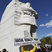 Demonstrators rally under the new Martin Luther King Jr. memorial in Washington, D.C., on Saturday.