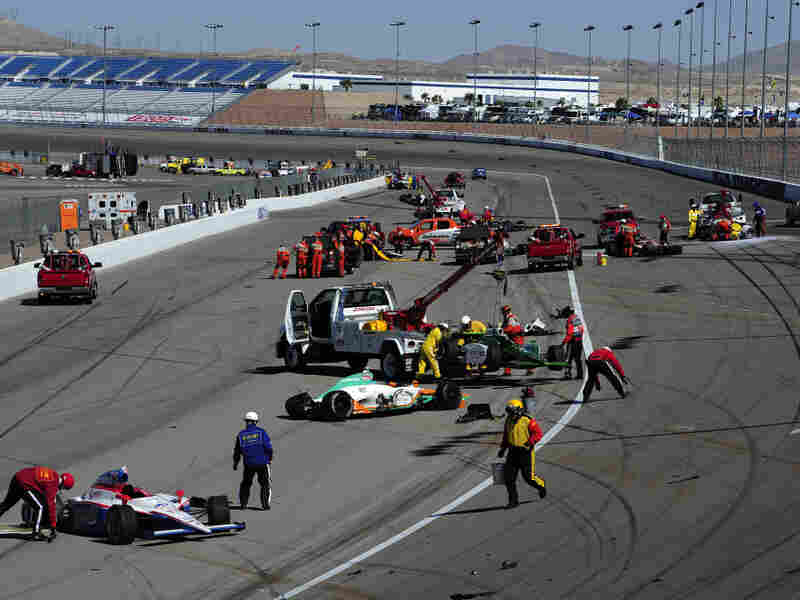 Cars are scattered on the track after the 15-car crash during at the Las Vegas Motor Speedway.