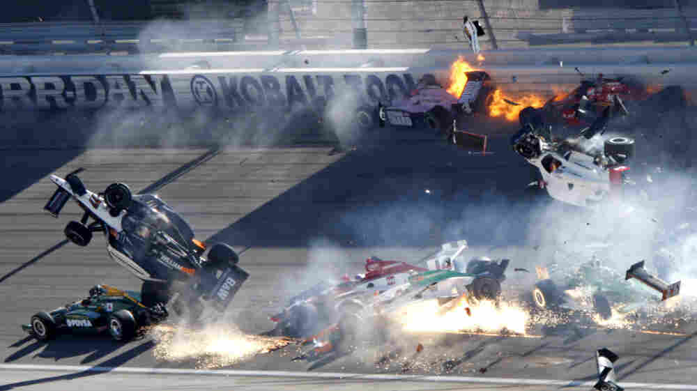 Drivers, including Dan Wheldon (77, in air at left), crash during the Las Vegas Indy 300 at the Las Vegas Motor Speedway Sunday. Wheldon was killed and three other drivers were injured in the crash.