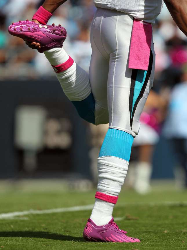 8761e88c852 Cam Newton  1 of the Carolina Panthers stretching as he wears pink for breast  cancer awareness ...