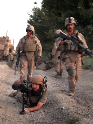 Director Danfung Dennis (bottom left) shot Hell and Back Again in part while embedded with Harris' unit — Echo Company, 2nd Battalion, 8th Marine Regiment.