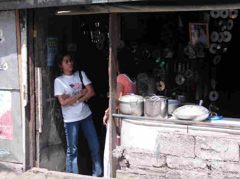 Teacher Angel Alim in front of her family's eatery in Antipolo, Philippines.