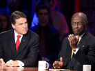 Herman Cain (right) speaks as Texas Gov. Rick Perry looks on during a GOP presidential debate at Dartmouth College on Oct. 11.