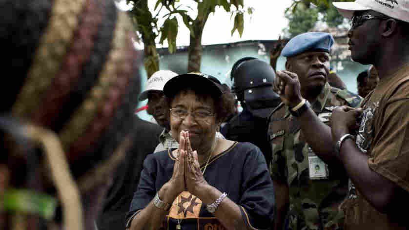 Liberian President Ellen Johnson Sirleaf addresses a crowd of supporters on Saturday outside offices of her party on the outskirts of Monrovia, Liberia's capital. She faces Winston Tubman in a runoff election scheduled for Nov. 8.