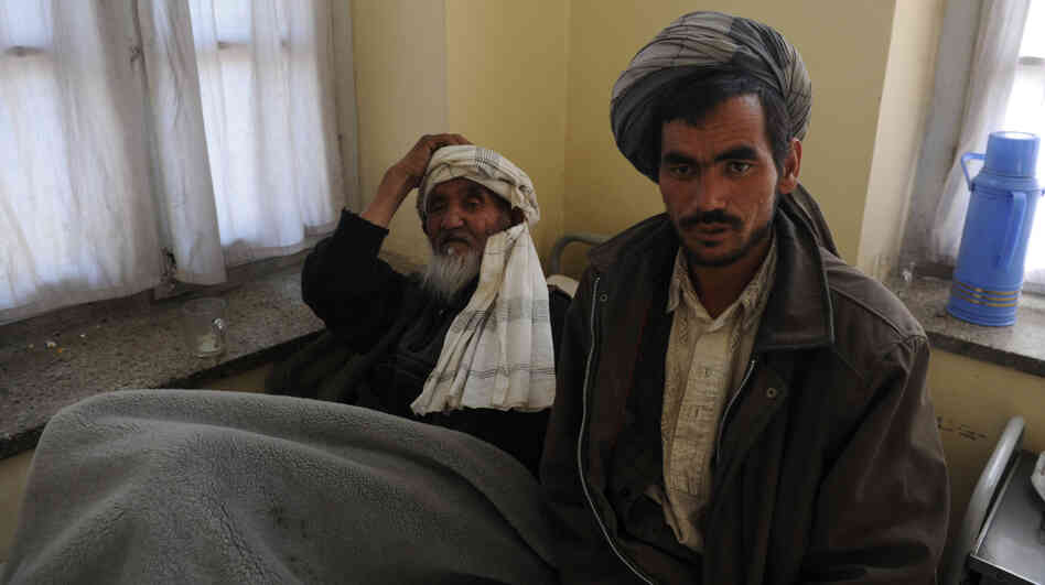 Afghan men wait to receive psychiatric treatment in a Kabul hospital. Scarred by decades of war, social problems and poverty, more than 60 percent of Afghans suffer from stress disorders and mental health problems.