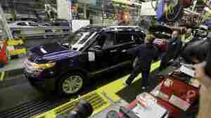 Workers put together a Ford Explorer on the assembly line at the automaker's Chicago plant in 2010.