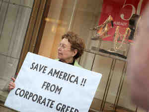 During an Occupy Chicago demonstration at the Bank of America building in Chicago, Kaye Gamble holds a sign protesting corporate greed.