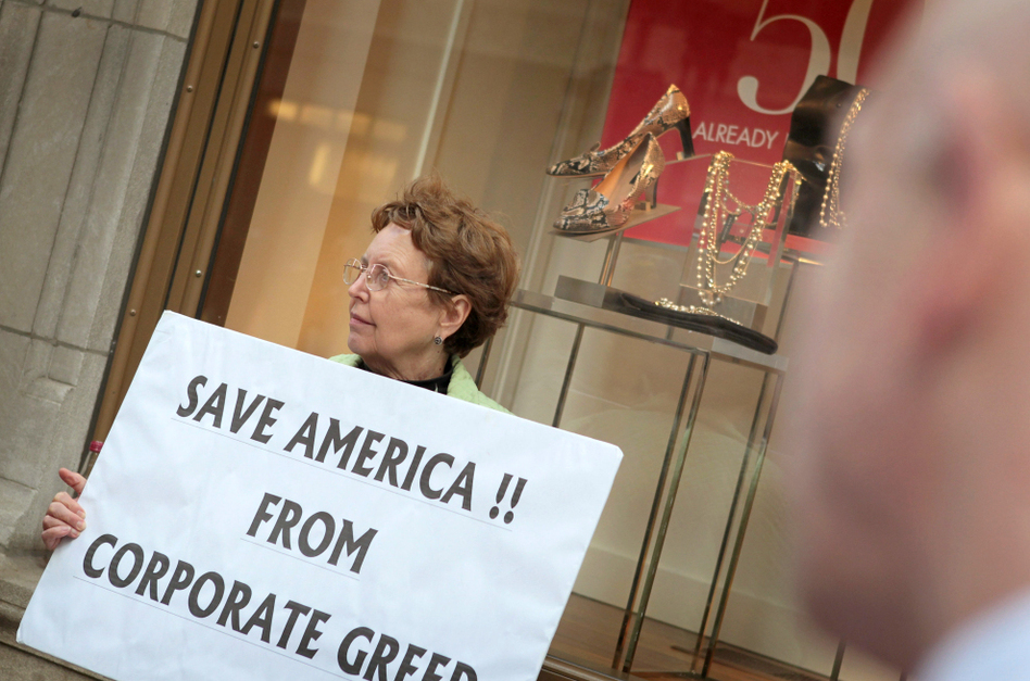 <p>During an Occupy Chicago demonstration at the Bank of America building in Chicago, Kaye Gamble holds a sign protesting corporate greed.</p> (Scott Olson/Getty Images)