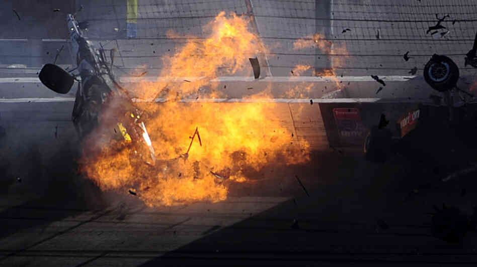 The car of driver Dan Wheldon  bursts into flames during the Las Vegas Indy 300. Wheldon, 33, was killed.