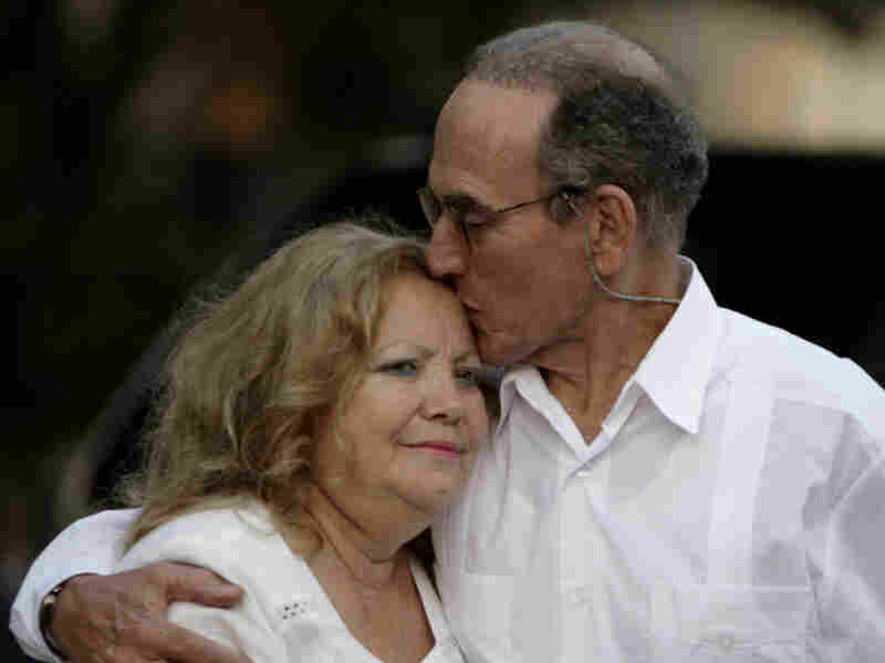 Pollan founded the Ladies in White after her husband, Cuban dissident Hector Maseda, was jailed. He was released in February this year. In this photo from March, Maseda kisses Pollan before a meeting with former U.S. President Jimmy Carter in Havana.