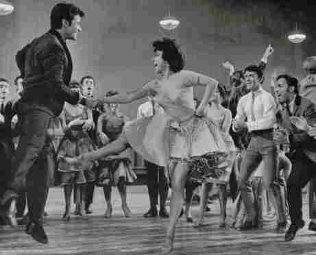 George Chakiris (left) and Rita Moreno (center) play the couple Anita and Bernardo in 1961's West Side Story.