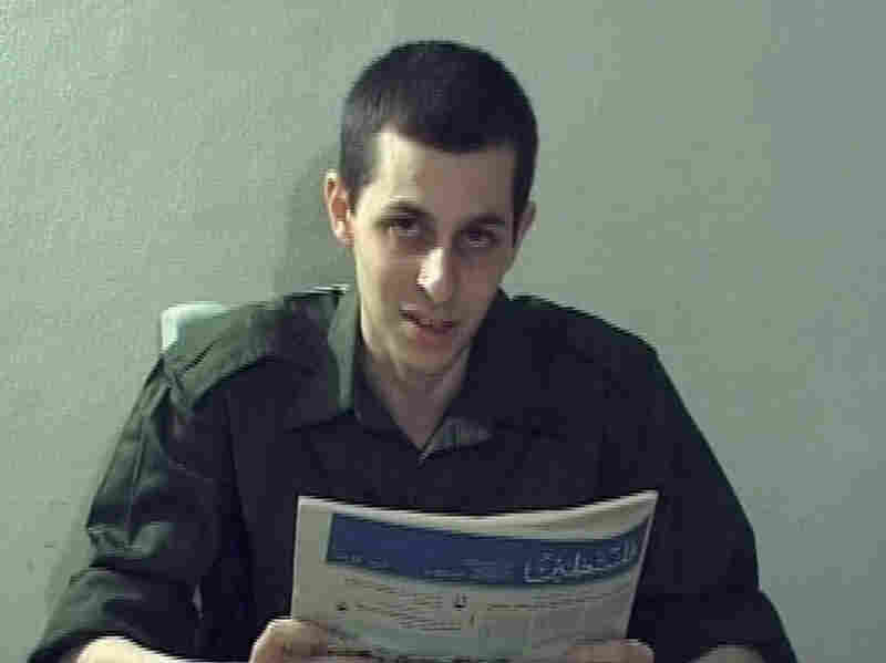 In this video grab released on Oct. 2, 2009, captured Israeli soldier Gilad Shalit is seen holding a Palestinian newspaper. Shalit, who has been held by Palestinians for more than five years, is set to be released Tuesday.