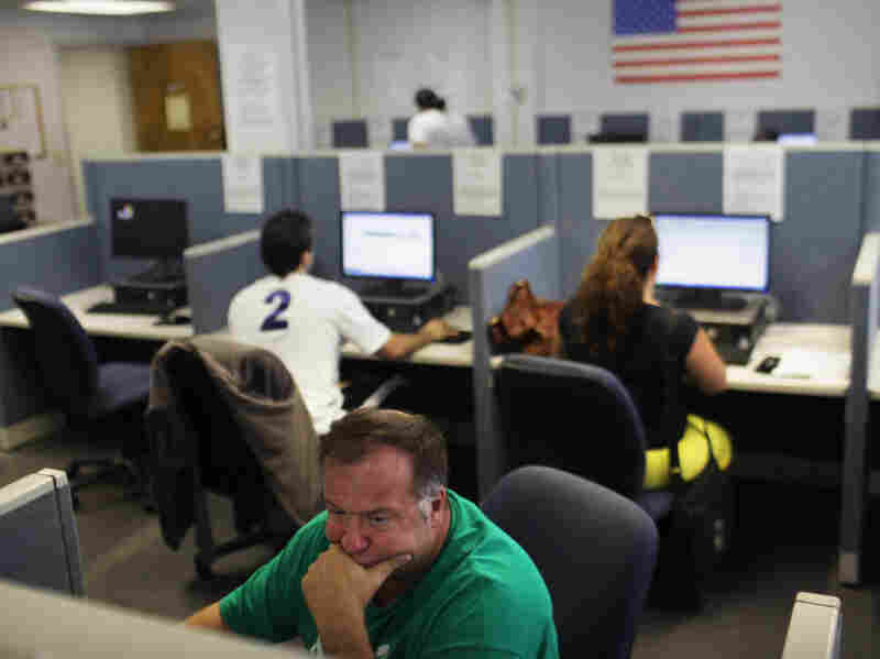 People search for jobs at the Suffolk County One-Stop Employment Center in Hauppauge, N.Y.