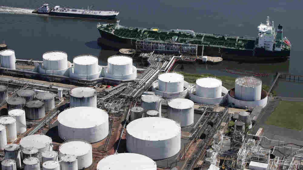 An oil tanker is docked at the Kinder Morgan terminal in Carteret, N.J. Kinder Morgan Energy Partners LP operates pipelines and terminals for oil and natural gas. The company's purchase of El Paso Corporation expands its pipeline to 80,000 miles.