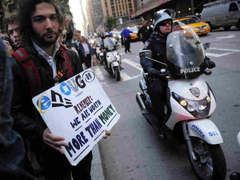 Occupy Wall Street participants walk on a protest march on their way to stage a demonstration on Times Square in New York, October 15, 2011.
