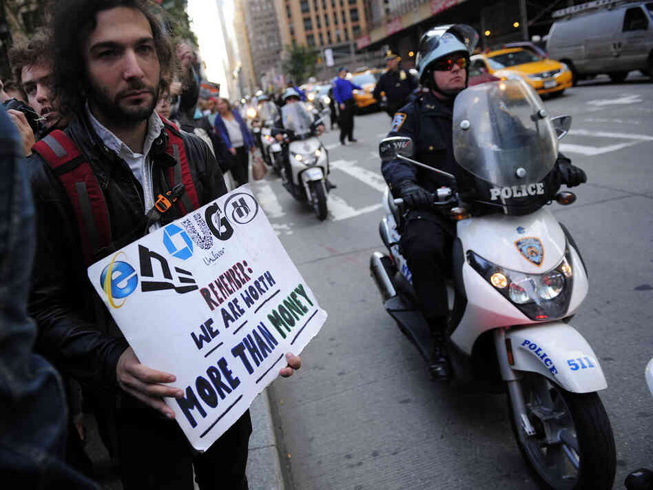 Occupy Wall Street participants walk on a protest march on their way to stage a demonstration on Times Square in New Yo