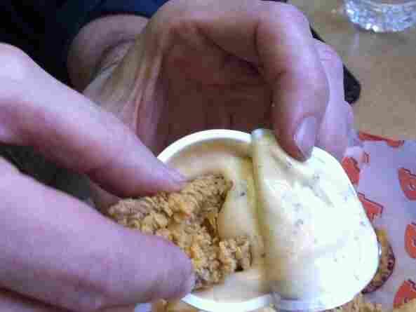 Dipping Dip'n Chick'n Chicken in Dip.