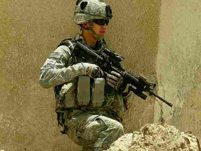 A U.S. Army soldier stands guard during a search for a weapons cache on June 5, 2008 in the al-Rahmaniya Shiite neighborhood north of Baghdad, Iraq.