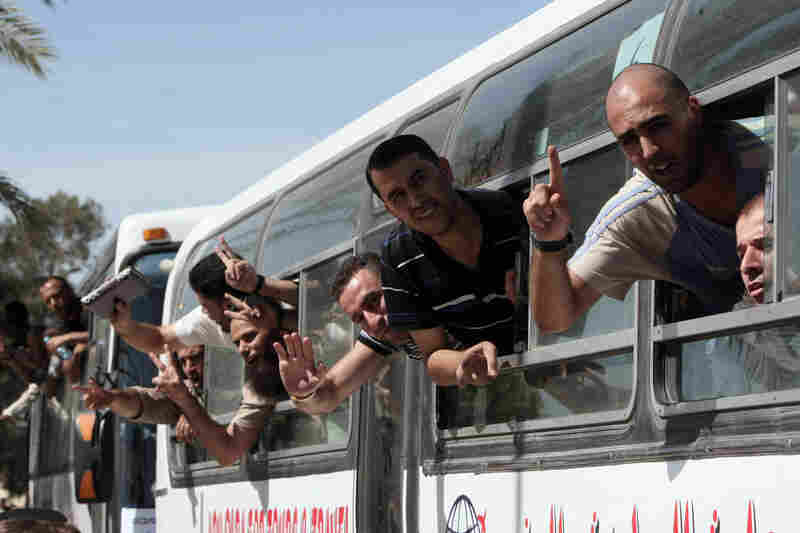 Palestinian prisoners cross from Egypt into the Gaza Strip on Tuesday after they were released from Israeli jails in a landmark prisoner swap.