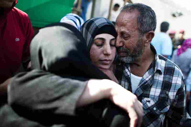 A Palestinian prisoner hugs relatives after arriving in Mukata following her release in Ramallah. A total of 27 women were set free Tuesday.