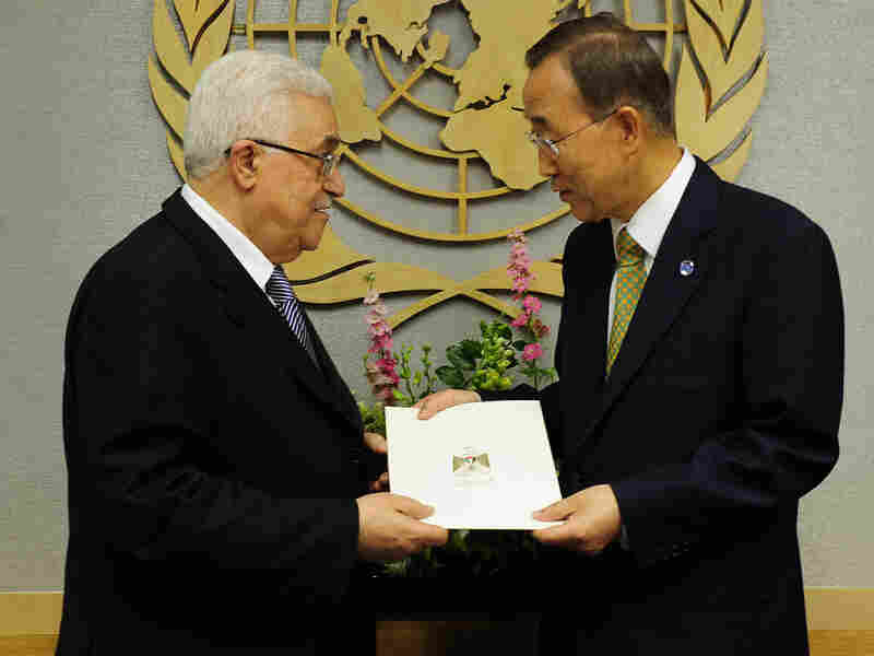 Palestinian Authority President Mahmoud Abbas (left) hands a formal letter for Palestine to be admitted as a state to U.N. Secretary-General Ban Ki-Moon during the 66th General Assembly at U.N. headquarters in New York, Sept. 23. Palestinians now are pursuing full membership in other U.N. agencies.