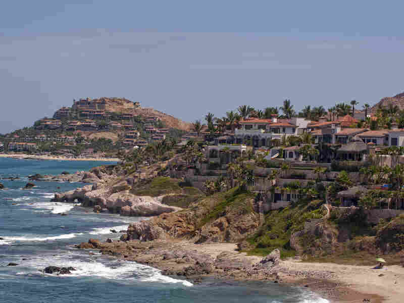 The number of people visiting Mexico — and staying at least one night in places such as Cabo San Lucas, in Baja California state (shown here) — has rebounded this year and is almost at a record level, according to the government.