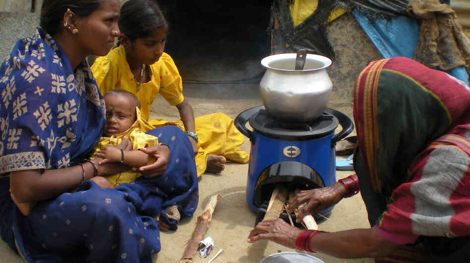 Women in India using an Envirofit clean cookstove to reduce indoor air pollution