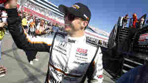 Dan Wheldon, of England, smiles during driver introductions for the IndyCar Series Las Vegas Indy 300 auto race Sunday, Oct. 16, 2011, in Las Vegas. Wheldon, a two-time Indianapolis 500 winner, died following a crash in the race.