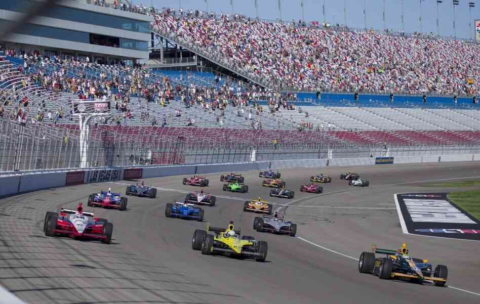 Drivers take five tribute laps in honor of Dan Wheldon, who died following a crash in the IndyCar Series Las Vegas Indy 300 auto race earlier Sunday. The race did not resume.