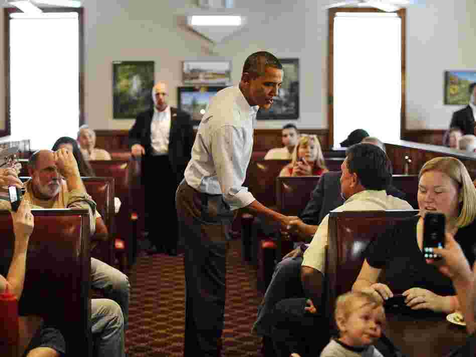 President Barack Obama chats with people after ordering his lunch at Countryside Barbecue in Marion, N.C., Monday, during the first day of his three-day American Jobs Act bus tour to discuss jobs and the economy.