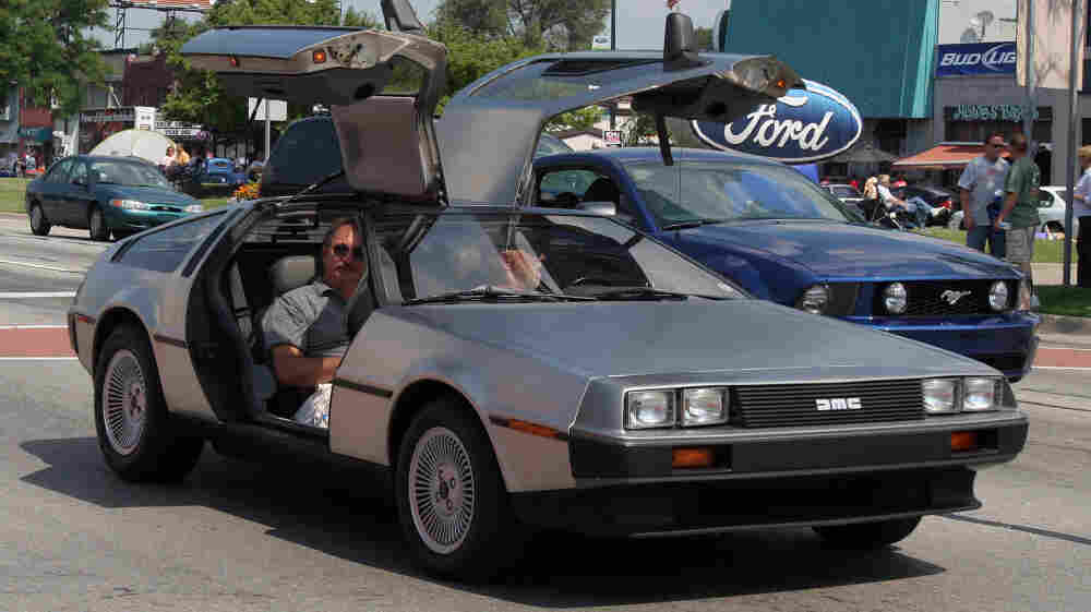 A 1981 DeLorean is seen in a commemorative cruise in Michigan. A Texas company plans to make electric versions of the iconic car.