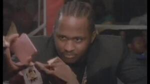 McDaniels says Kane's foe, holding up the Joker in this scene, appeared in the video to scare off anyone who might think of robbing Big Daddy Kane.