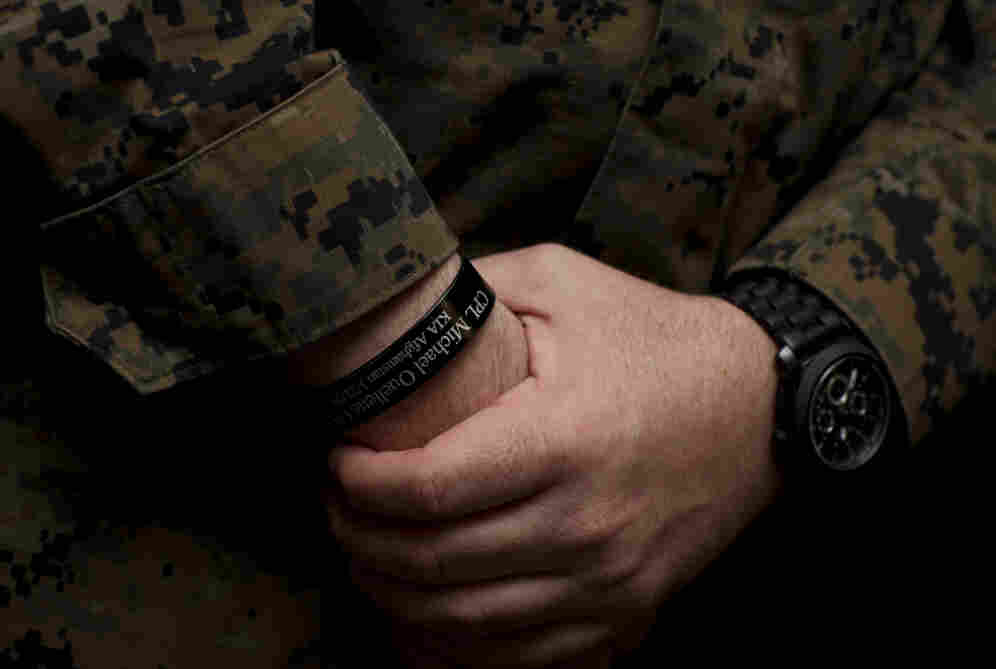 Petty Officer 3rd Class Matthew Nolen, a corpsman with Company L, 3rd Battalion, 8th Marine Regiment, wears a memorial bracelet or KIA (killed in action) bracelet in honor of his fallen squad leader Cpl. Michael W. Ouellette, who was killed during a patrol in Afghanistan.
