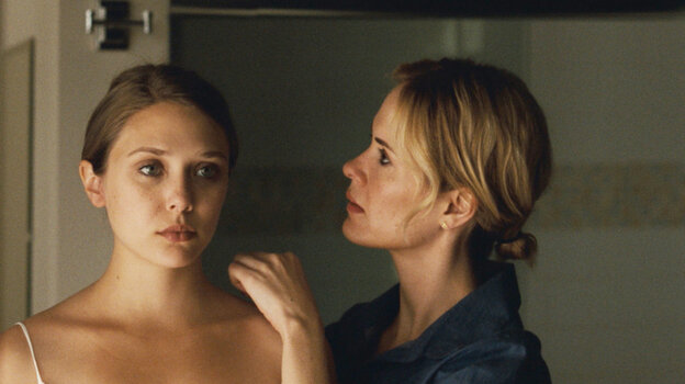 Elizabeth Olsen (left) plays Martha — or is she Marcy? May or Marlene? — a strained and strange young woman who has fled a cult's rural commune to take refuge with her sister (Sarah Paulson).