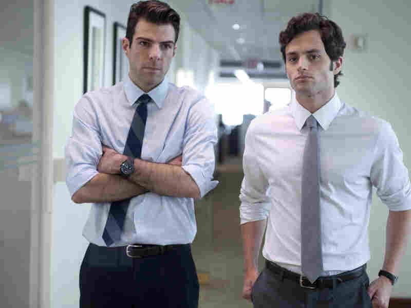 A junior analyst (Zachary Quinto, left) and his colleague (Penn Badgley) find the flaw in the formula that could bring down their company — and the economy.