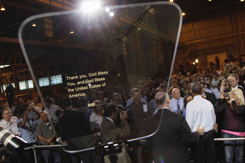 President Obama shakes hands in Bettendorf, Iowa, June 28, 2011, his teleprompter in the foreground.